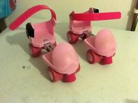 Pink overshoe rollerskates