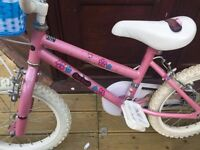 girls bike with blue basket suitable 4 - 8 years approx