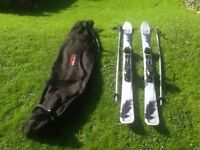 Skis with poles and bag