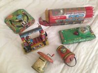 Collection of vintage tin toys .