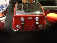 DeLongi top spec toaster,in red,perfect working order and condition,only £15,pos local delivery