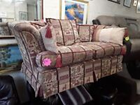 Patterned two seater sofa Copley Mill LOW COST MOVES 2nd Hand Furniture STALYBRIDGE SK15 3DN
