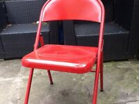 4 fun, red metal garden / dining chairs.
