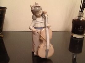Lladro of girl with double base