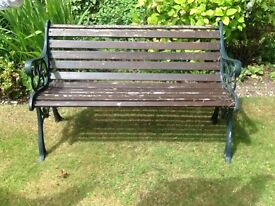 Ornate iron and wooden garden bench