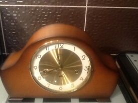 Old chiming mantle clock. Has 3 different chimes, walnut colour, in excellent condition.