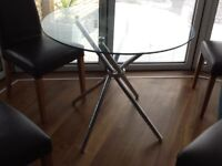 Glass dining room table circular 3 foot diameter with chrome legs