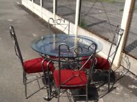 Reduced glass table and chairs