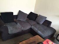 Corner sofa in black/grey