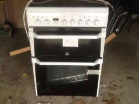 indesit free standing ceramic hob fan assisted oven brand new little dent on side reflects on price