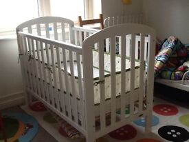 Cot (make Obaby), has a drop side, 2 height levels for mattress, smoke free home, good condition