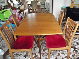 Teak Table with protective felt and four matching padded chairs