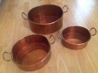 Three vintage large copper pans,large.