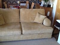 Large 3 seater sofa with light coloured feet