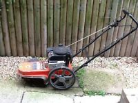 Ariens wheeled trimmer with Briggs and Stratton engine.