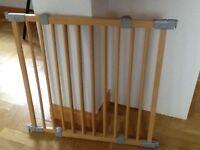 Extending wooden baby gate.