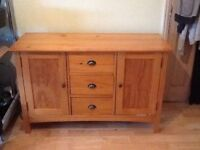 Bedroom dresser 3 drawers and 2 cupboards. Heavy oak wood with iron handles.