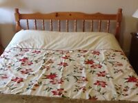 Pine double bed with mattress .