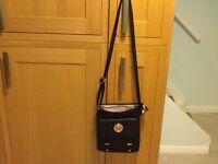 Black messenger bag , never used cream lining