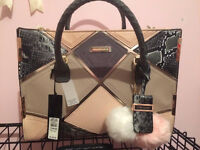 river island bag with pom pom's
