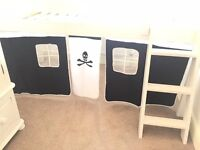 Pirate cabin bed curtains.