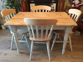 Solid wood farmhouse dining table with four chairs