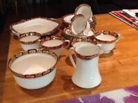6 cups saucers plates, milk jug .,sugar bowl and cake plate