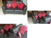 2 BLACK LEATHER 2 SEATER SOFAS ULTIMATE COMFORT AND VERY MODERN IDEAL IF YOU HAVE A SMALL ROOM
