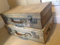 Two hard leather vintage decorative suitcases.