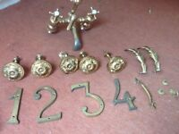 Mixed lot of brass items including curtain tie backs and mixer taps