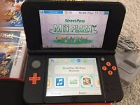 Nintendo 3DS XL - Orange and Black + games and accessories