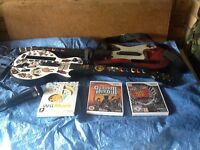 2 Wii guitars, microphone and discs