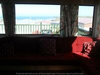 AMAZING SEA VIEWS, LARGE ENCLOSED DECKING TWO BEDROOM 6/7 BERTH CARAVAN TO LET PERRANPORTH CORNWALL