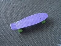 Penny board original. Lilac deck with green wheels, hardly used