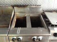Falcon freestanding twin basket gas fryer.