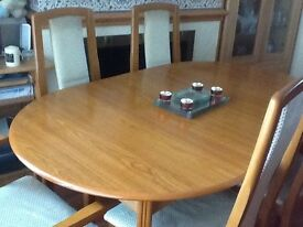 Extending dining table and six chairs two of them cravers