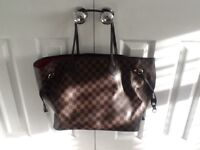 Ladies Louis Vuitton like bag and wallet.