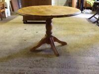 Round pine table, on wooden pedestal