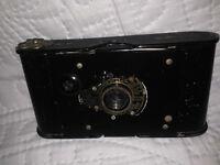vintage vest pocket kodak camera and case,1913.