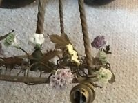 A genuine vintage pretty brass ceiling light, with hand made porcelain flowers, brass leaves