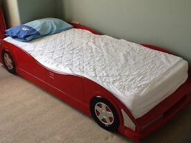 Single car bed for sale , solid wood in excellent condition incl mattress. Urgent sale £95