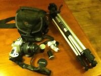Canon Rebel 2000 EOS WITH 28-80mm lens, Lowepro camera bag, tripod, B&W and color film, etc.