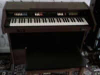 Organ. Different instrument sounds on it. Name on the front Gem Wizard 315.