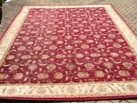 Large red rug in good condition.