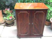 Mahogany wood tv cabinet.