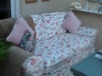 Double size brown sofa bed with removable floral cover buyer to collect £50 ono