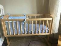 Mother care swinging wooden crib