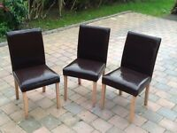 Three Brown Chairs