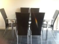 Rectangular Glass table with 6 black leather effect chairs