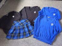 The Roseland School uniform jumpers skirts and socks left